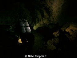 N. Florida cave diver with doubles leaving the cavern zon... by Nate Ewigman 